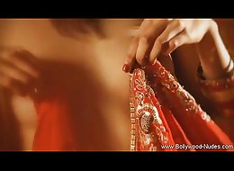 * Red sari Indian lady dances and strips and seduce
